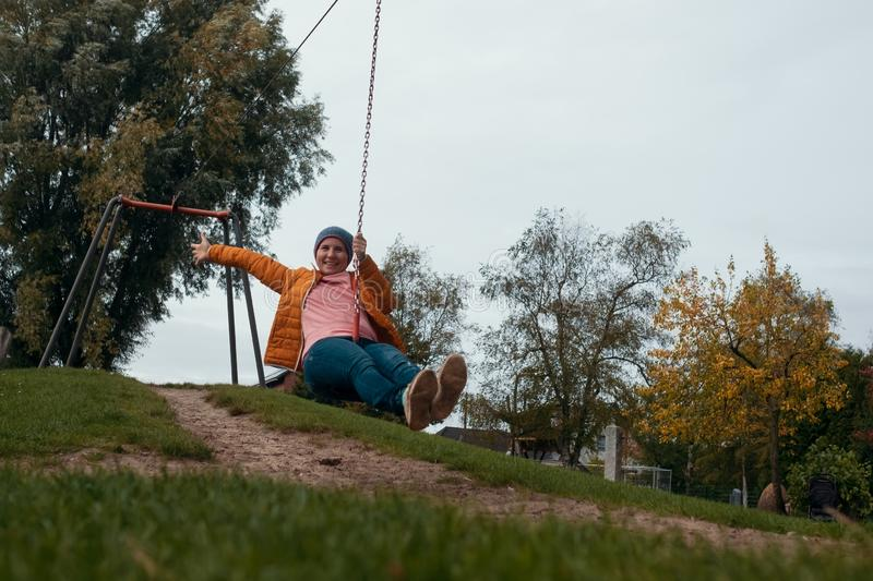 Caucasian woman having fun in zip line stock image