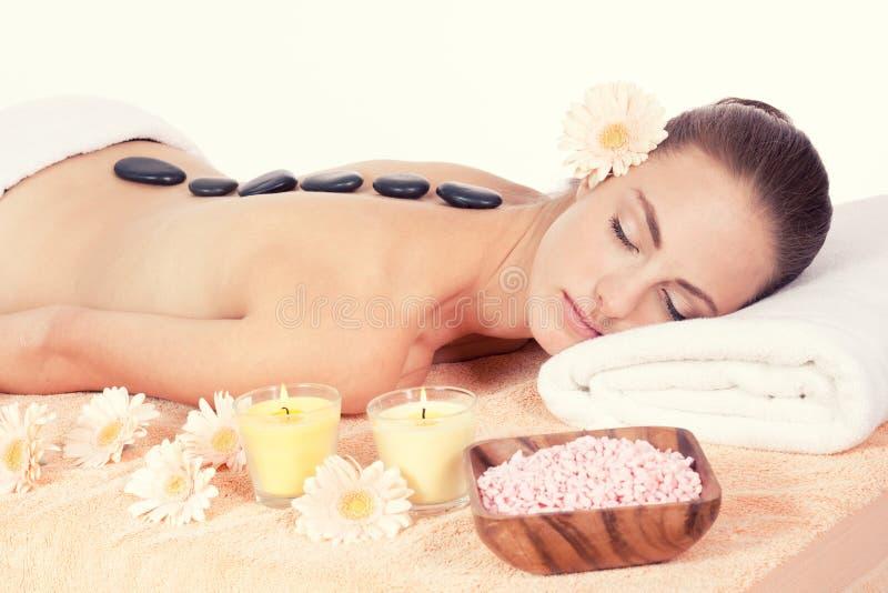 Caucasian woman hot stone massage wellness. Attractive helathy caucasian woman hot stone massage wellness spa therapy stock image