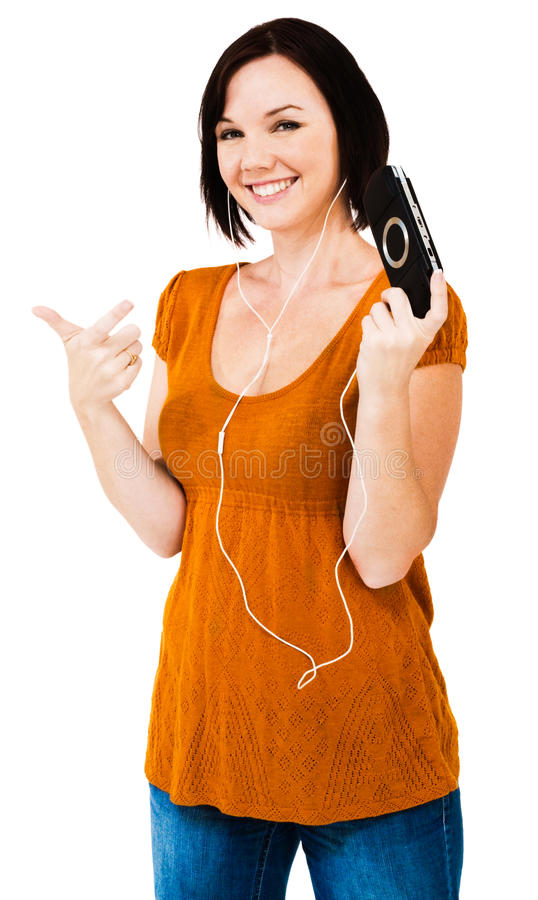 Caucasian woman listening media player. Caucasian woman listening to music on an media player isolated over white stock image