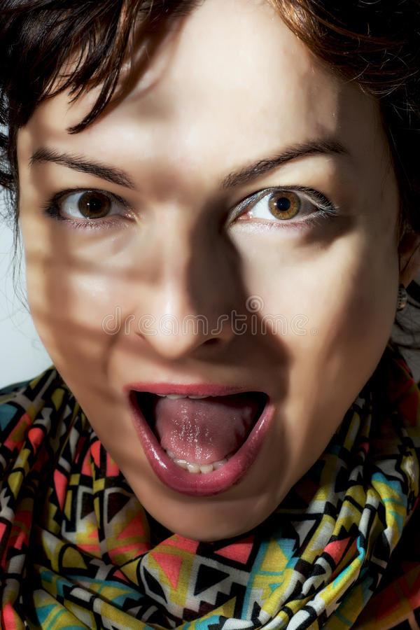 Caucasian woman making surprised face. Mouth wide open stock image