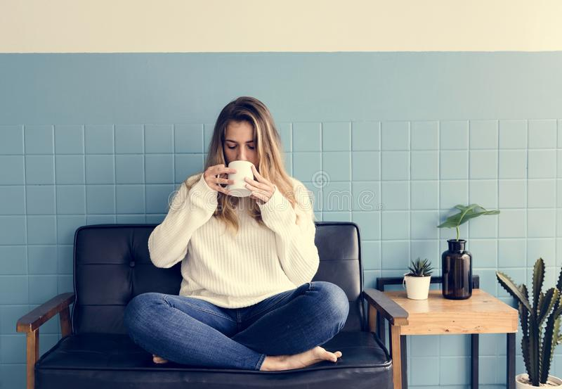 A Caucasian Woman Sitting and Drinking Coffee royalty free stock photo