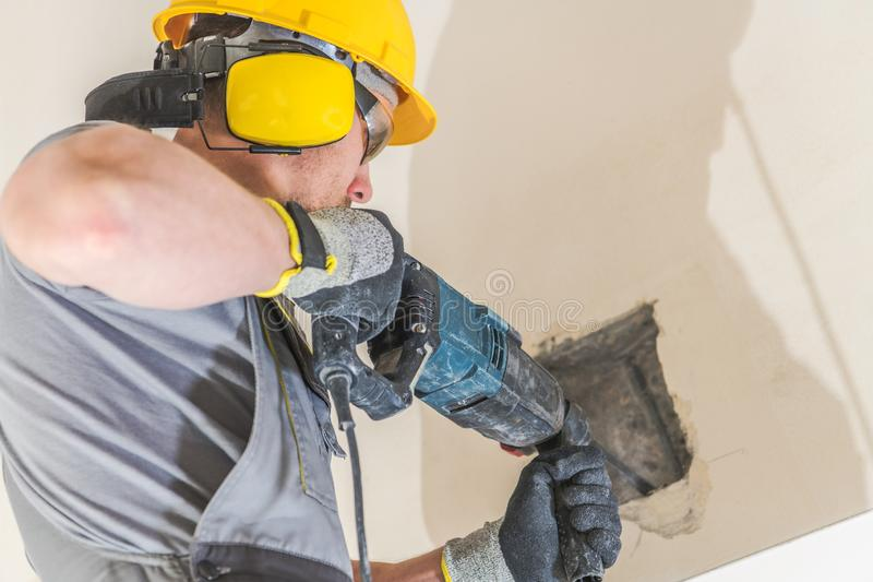 Worker Chiseling Concrete stock photo