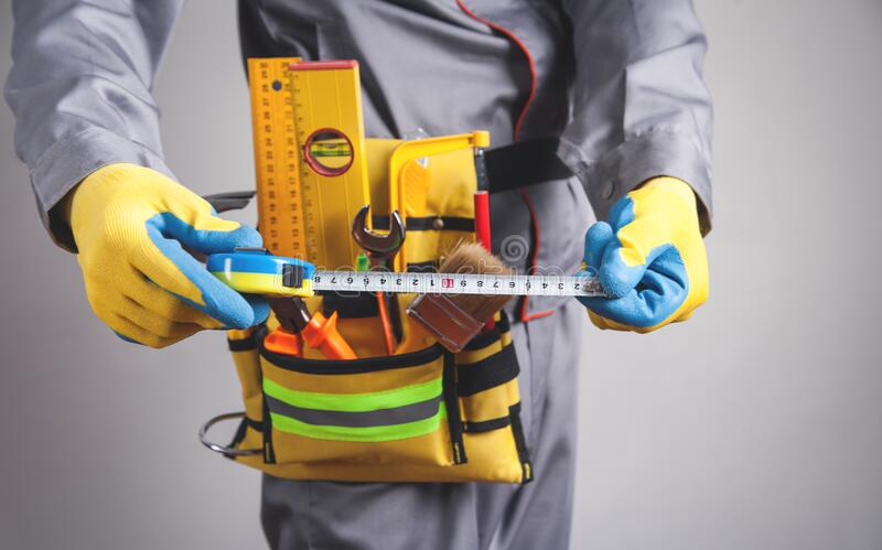 Caucasian worker holding a tape measure stock images