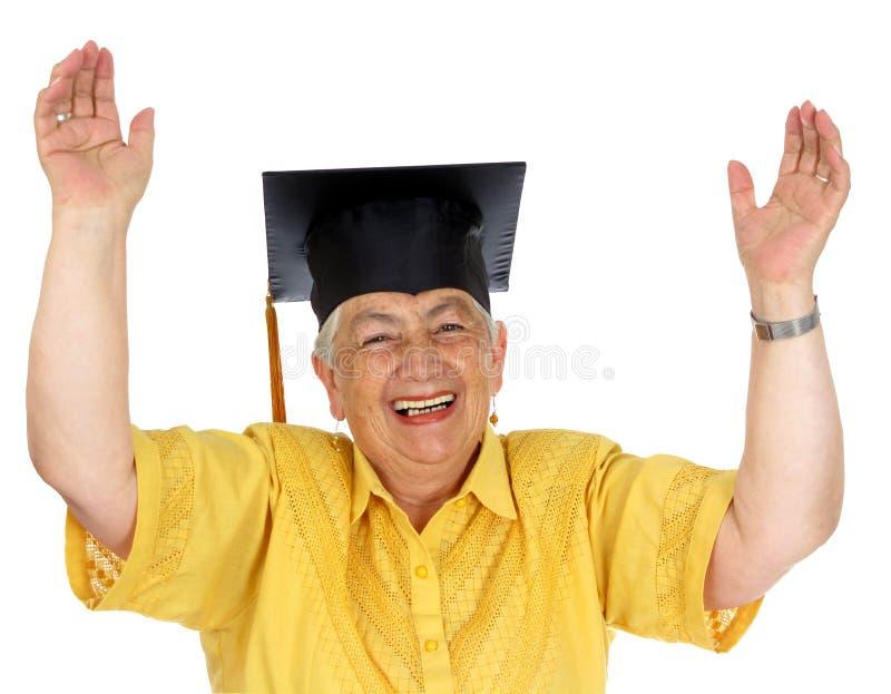caucasian yellow för kvinnligkappaavläggande av examen royaltyfri bild