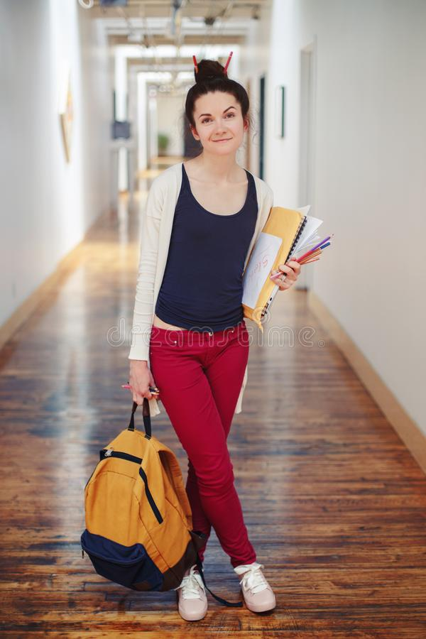 Caucasian young brunette woman student female drawing designer artist in hall of college university royalty free stock image
