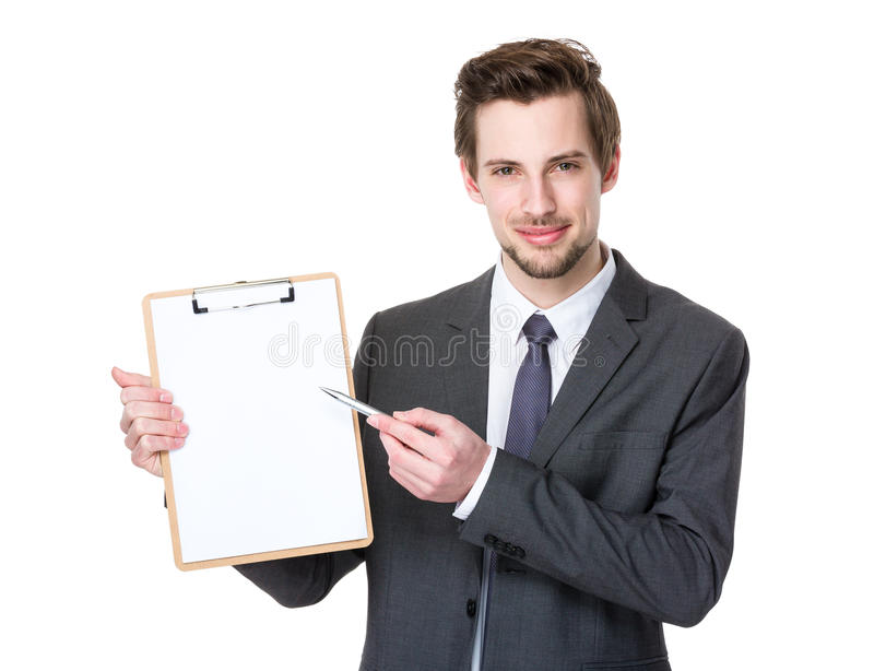 Caucasian young businessman pen point to clipboard stock images