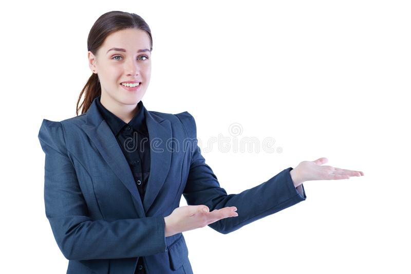Young Caucasian woman holding her arm out and showing copy space for product. Isolated over white background. royalty free stock photography