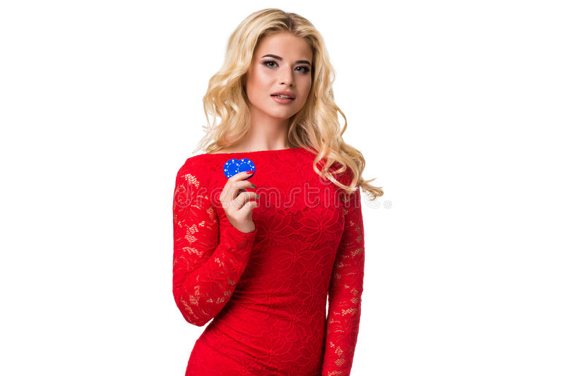 Caucasian young woman with long light blonde hair in evening outfit holding playing chips. Isolated. Poker. Caucasian young woman with long light blonde hair in stock image