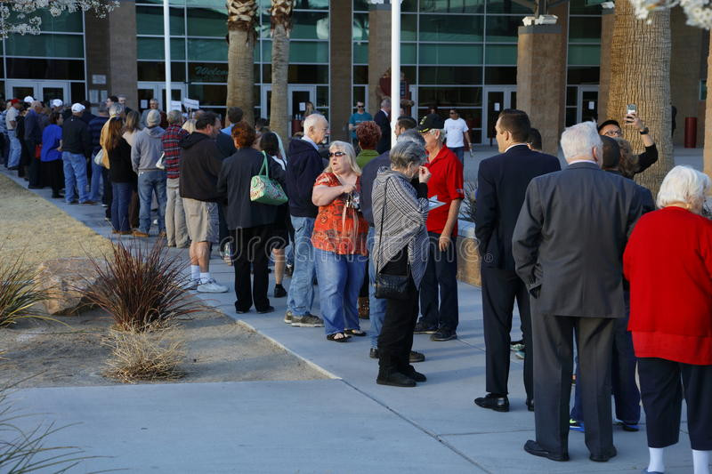Caucus goers and voters wait in line to enter a caucus location in Las Vegas, Nevada, U.S., on Tuesday, Feb. 23, 2017 stock image