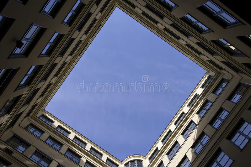 This caught my attention. A view from a frog perspective inside a building complex royalty free stock photos