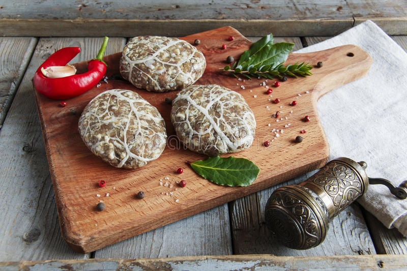 Caul-Fat Meatballs raw burger cutlet handmade on desk stock photo
