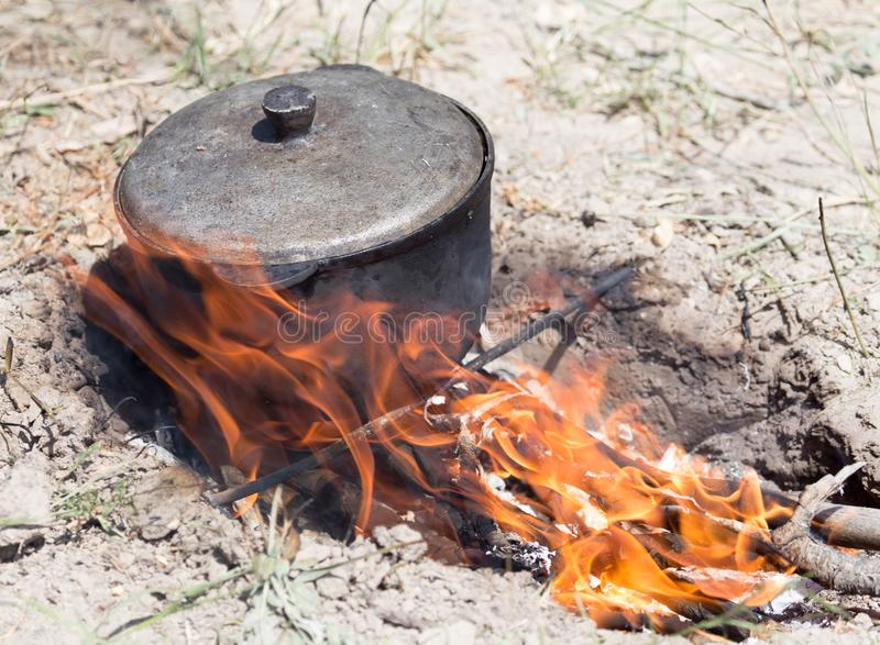 Cauldron on the fire on the nature royalty free stock photography
