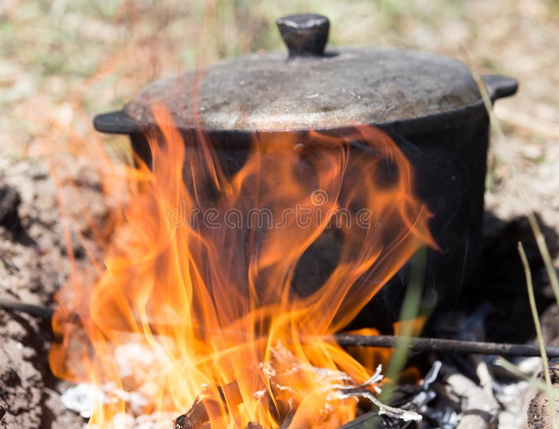 Cauldron on the fire on the nature stock image