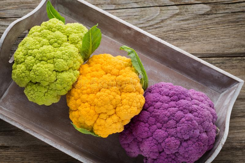 Cauliflower. Rainbow of eco on the wooden table royalty free stock image