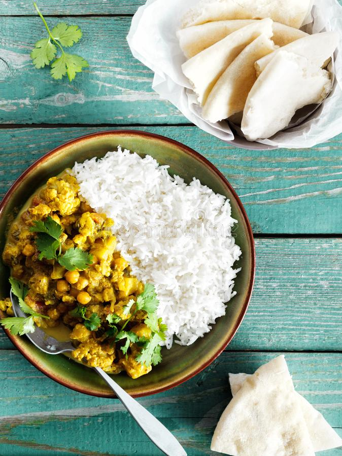 Cauliflower spicy curry rice naan bread copy space top view stock photos