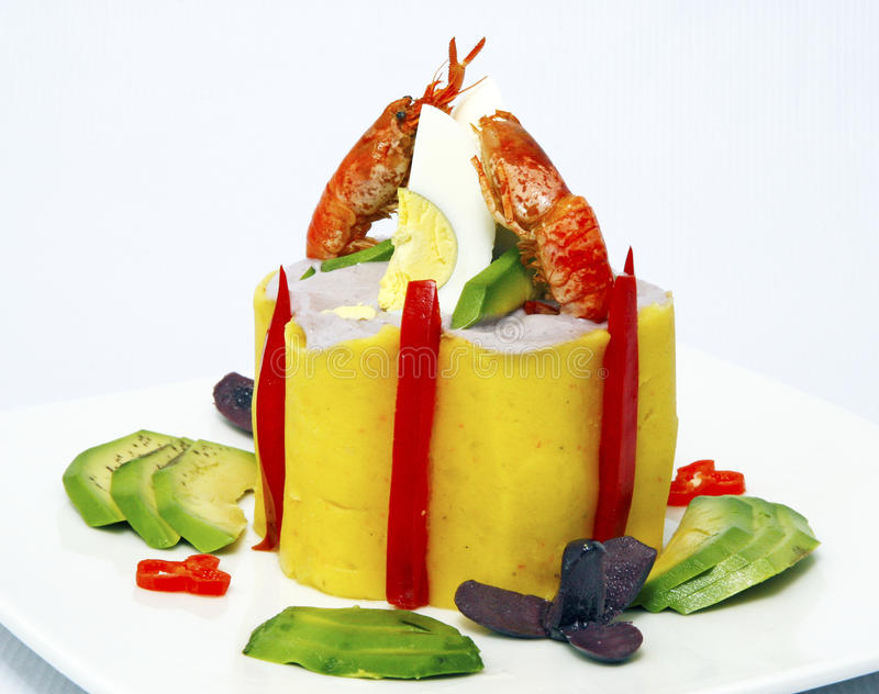 Causa, a Peruvian dish made of mashed potato mixed with aji (hot pepper) and lime and filled with vegetables (corn, peas stock photos