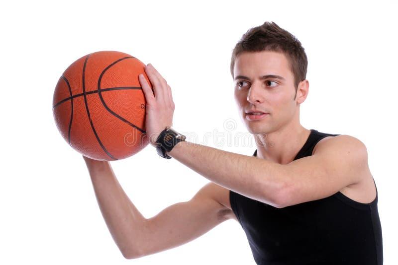 Download Causal Man Holding Basketball Ball Stock Image - Image: 5374189
