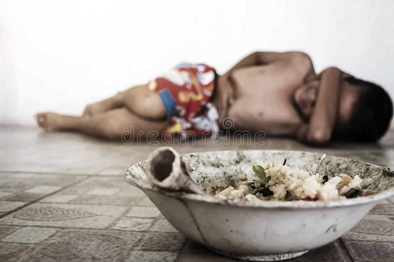 Causes of food poisoning. Little boy lay down after eating moldy rotten food on ground with gradient and shadow edge, poverty and lacking concept royalty free stock photography