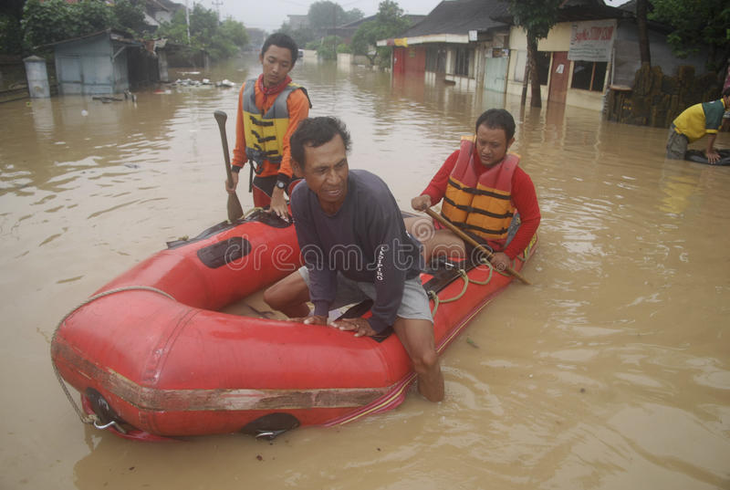 CAUSES OF INDONESIA SEASONAL FLOODING. A scene of flooded area in Solo, Java, Indonesia. Damaged environmet at river streams, deforestations, and bad urban royalty free stock photo
