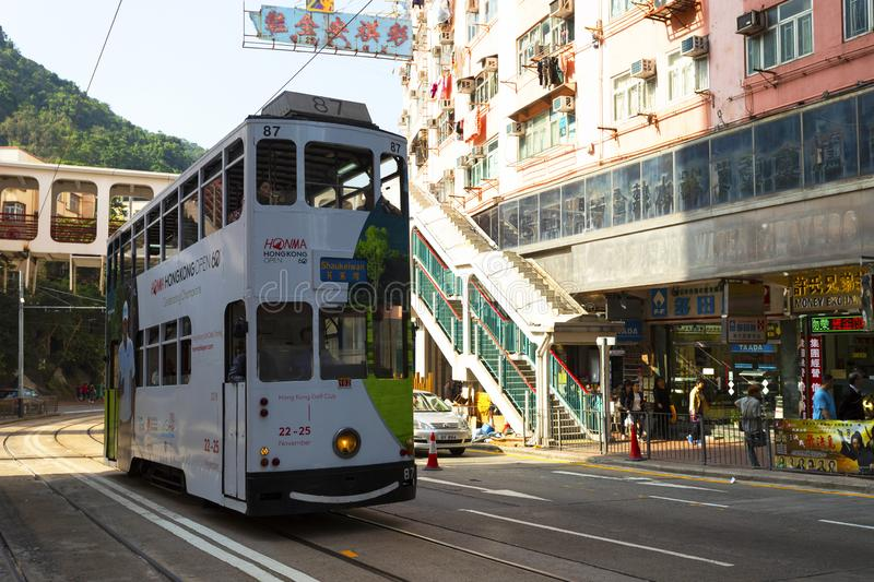 Causeway Bay, Hong Kong - 23 November 2018: Double-decker tram Trams are also a major tourist attraction and one of the best eco-. Friendly travel destinations stock photos