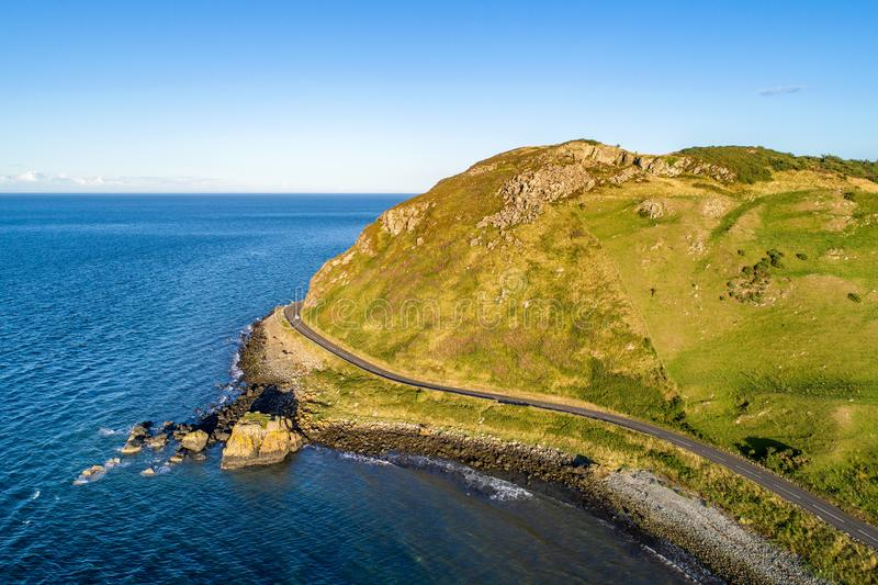 Causeway Coastal Route in Northern Ireland, UK. Northern Ireland, UK. Causeway Coastal Route a.k.a Antrim Coast Road near Ballygalley Head and resort. One of the stock image
