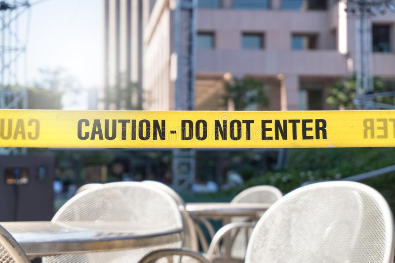 Caution, do not enter line tape and ribbon in city. royalty free stock photo