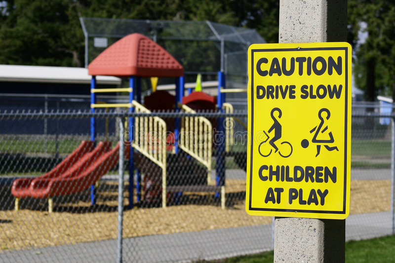 Caution Drive Slow Playground stock images