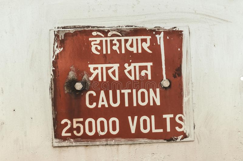 Caution 25000 high voltage safety warning sign in a clear and straight instructions to communicate at work with everyone for. Spreading awareness about a stock photography