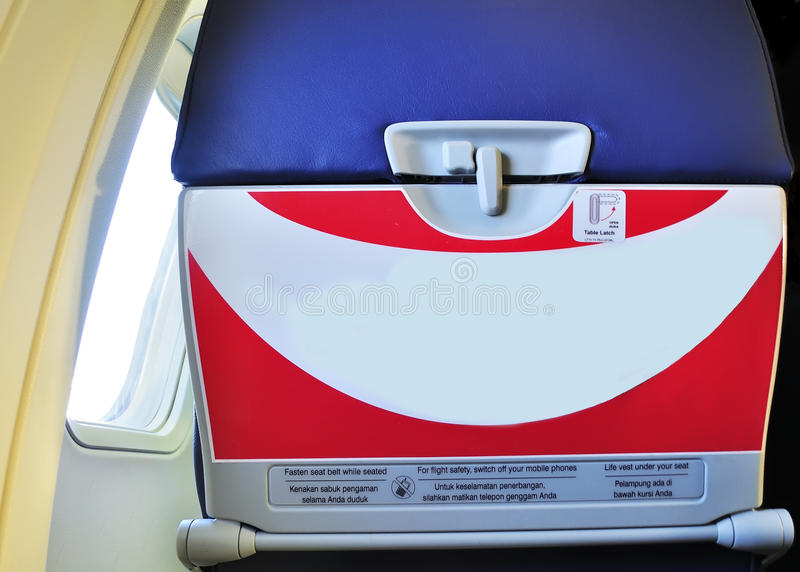 Caution label on the airplane. Fasten seat belt while seated, for flight safety, switch off your mobile phone, life vest under your seat. suitable for aviation stock photography