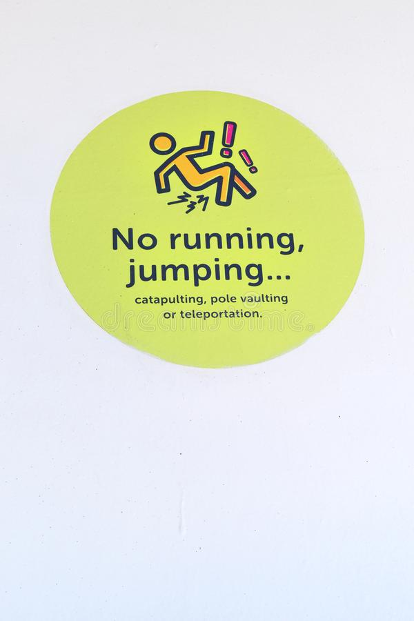 Caution no running, jumping sign stock images