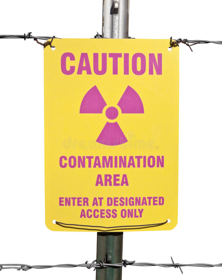 Caution Radioactive Contamination Area Sign. Caution radioactive contamination warning sign with barb wire fence isolated royalty free stock image
