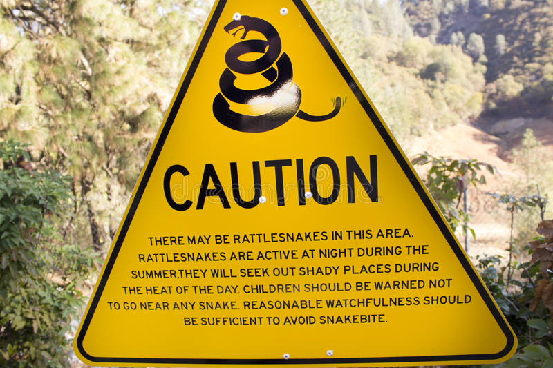 Caution of Rattlesnakes Sign royalty free stock photo