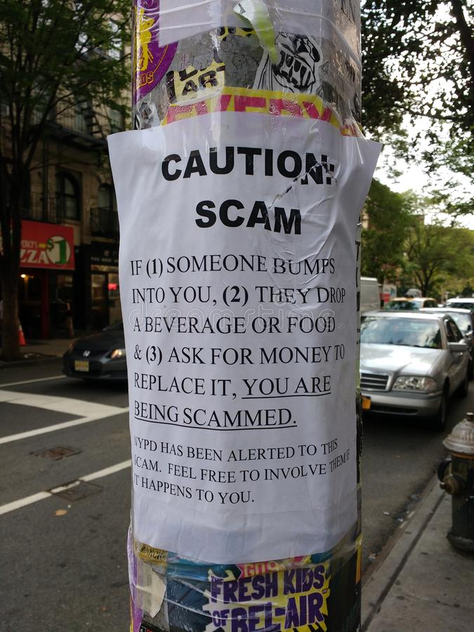 Scam, Be Alert of Scammers, Caution, NYC, NY, USA royalty free stock photography