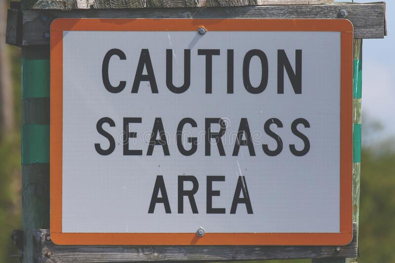 Caution Seagrass Area Sign stock image