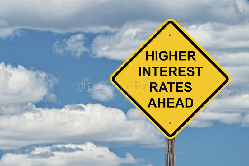 Caution Sign Blue Sky - Higher Interest Rates. Caution Sign Blue Sky Background - Higher Interest Rates Ahead royalty free stock photography