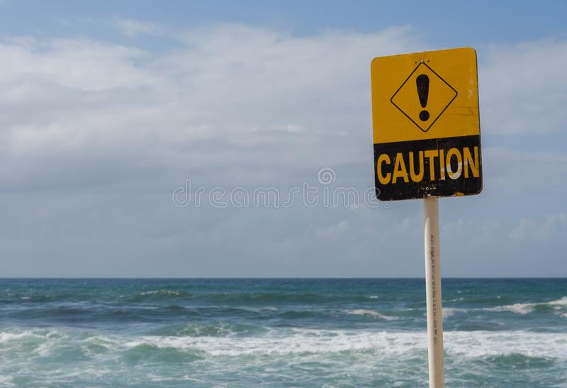 Caution sign at rough surf conditions in landscape format. No people stock images