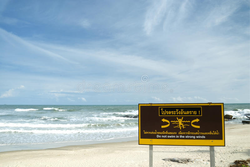 Caution Sign On White Sand Beach Royalty Free Stock Image