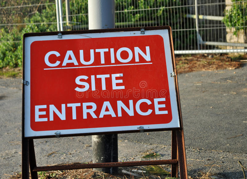 Download Caution site entrance sign stock image. Image of clouds - 38754759