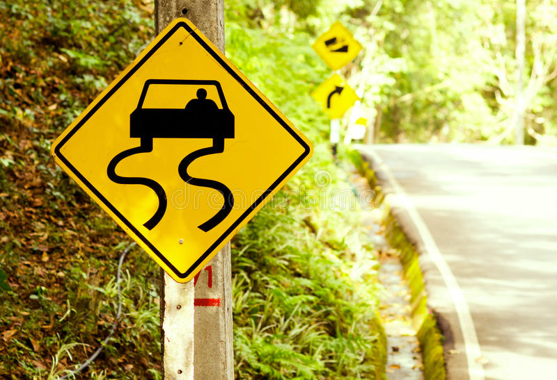 Caution of slippery roads - traffic signs beside country road. (ramp, signs, traffic royalty free stock photo
