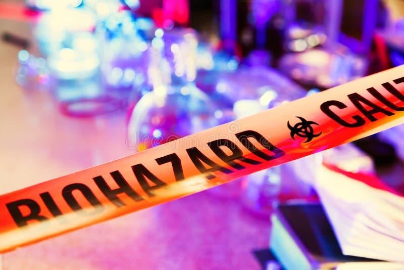Caution tape in hazardous biochemicals laboratory royalty free stock image