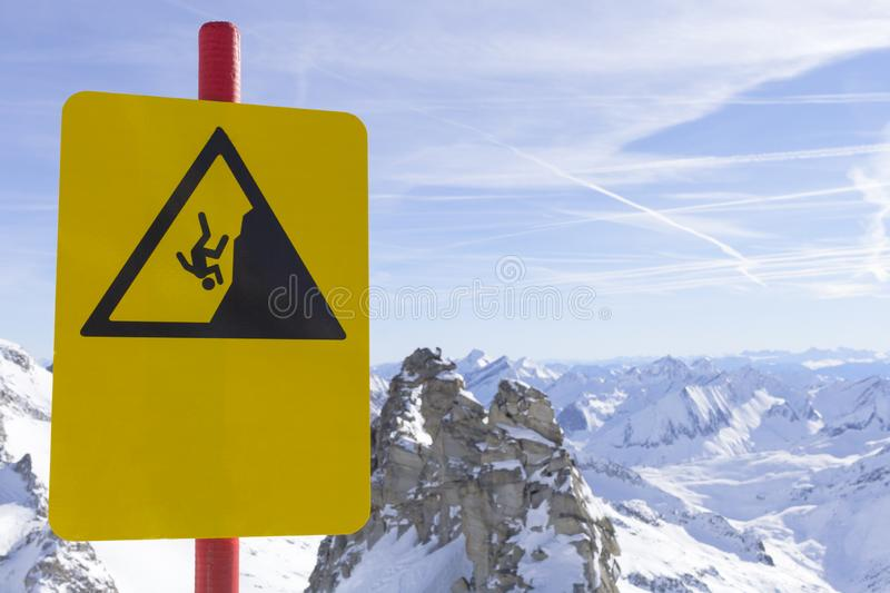Caution warning sign in mountains ski resort - carefully down the cliff. Alpine Alps mountain landscape at Tirol, Top of. Caution warning sign in mountains ski stock photos