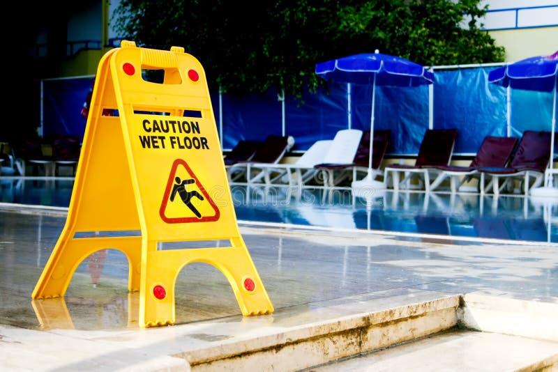 Caution wet floor sign stock photography