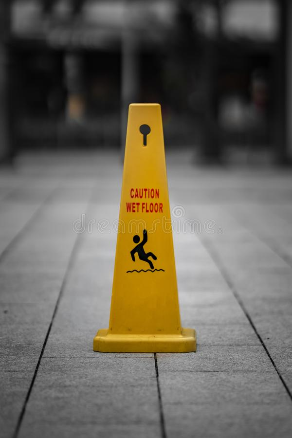 Caution Wet Floor Warning Sign. Be Careful Symbol To Keep Your Safe royalty free stock image