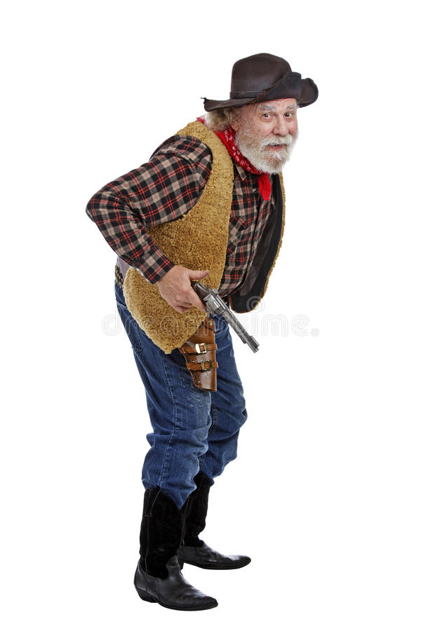 Cautious old cowboy ready with his gun royalty free stock images