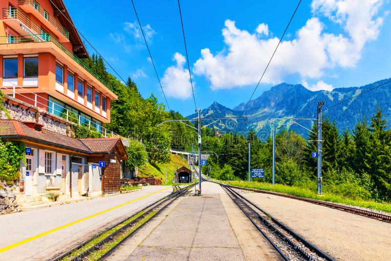 Caux cogwheel railway station in Switzerland. Scenic summer view of Caux cogwheel railway station on the way up to the Rochers de Naye mountain peak in Alps stock photography