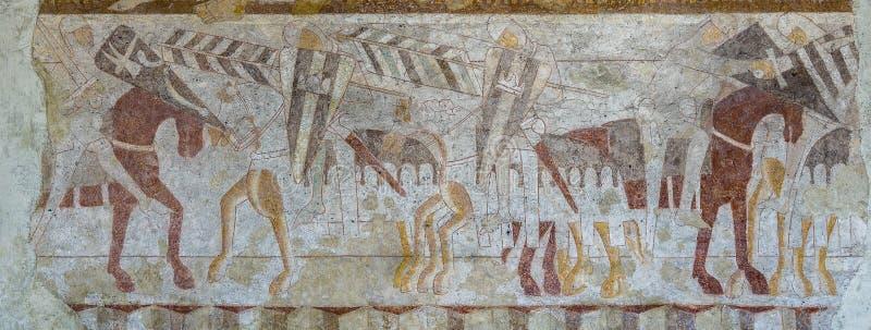 Cavaleiros cristãos contra pagão Fresco medieval de uma batalha fotos de stock