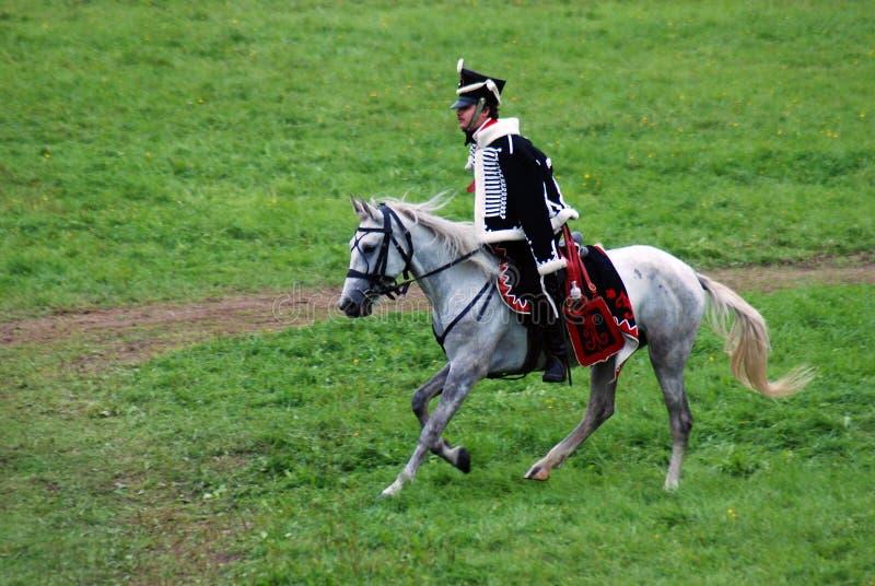 Cavalier de cheval à la reconstitution historique de bataille de Borodino en Russie image libre de droits