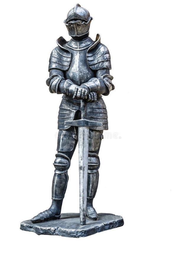 Cavaliere del ferro Un guerriero in armatura con una spada dai medio evo immagini stock