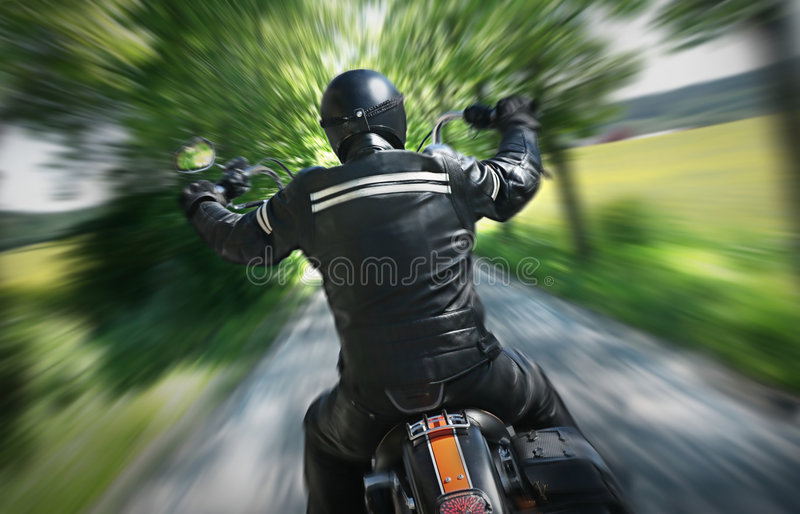 Cavaliere solo della motocicletta fotografia stock