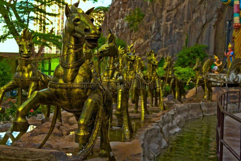 Cavalli dorati in caverne Gombak Selangor Malesia di Batu immagini stock libere da diritti